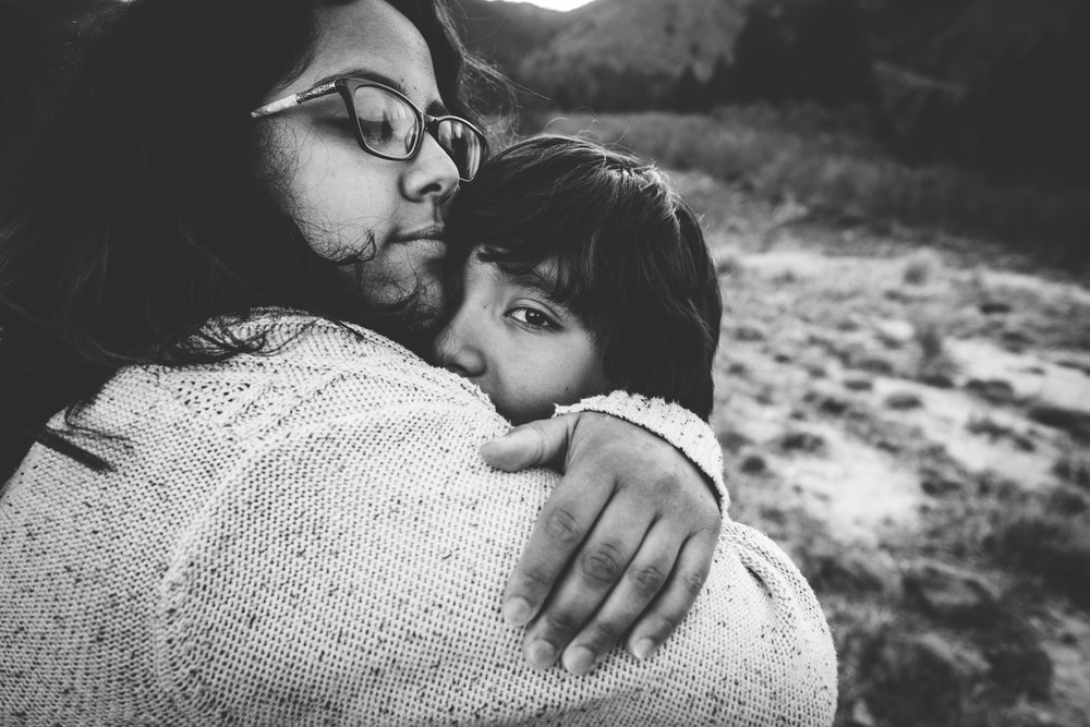 Mother and son embrace during family photo session in Colorado Springs mountains.