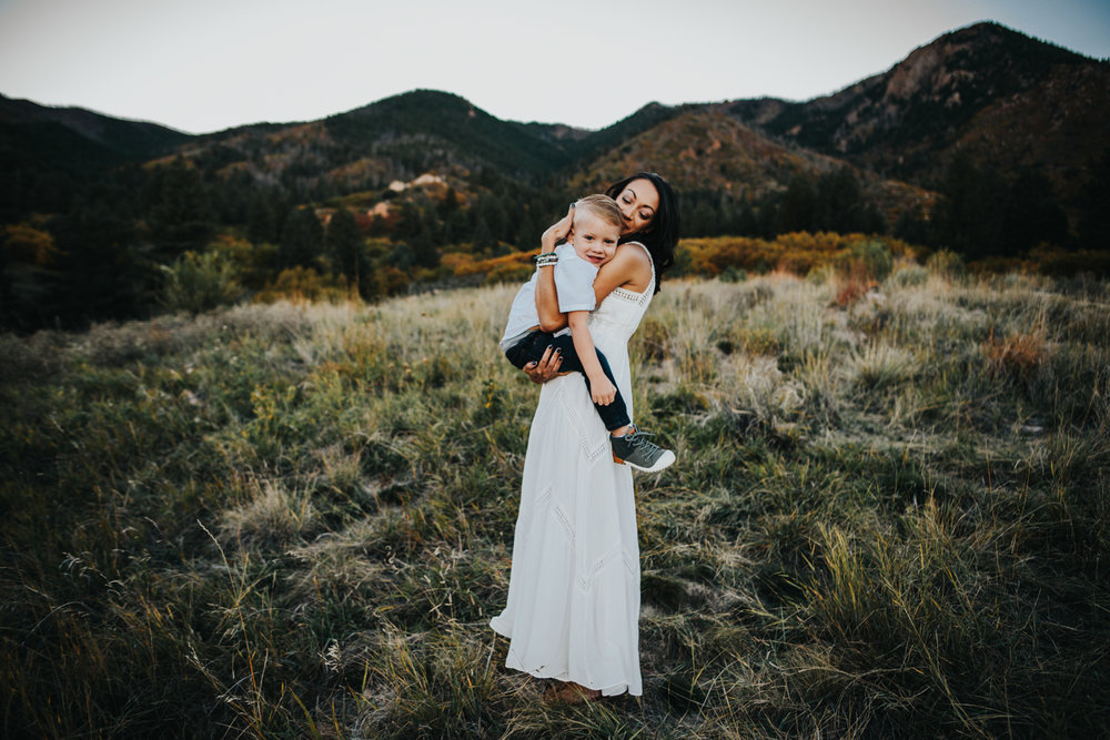 Sweet and stylish mother and son hug during photography session at Blodgett Peak Open Space in Colorado Springs.