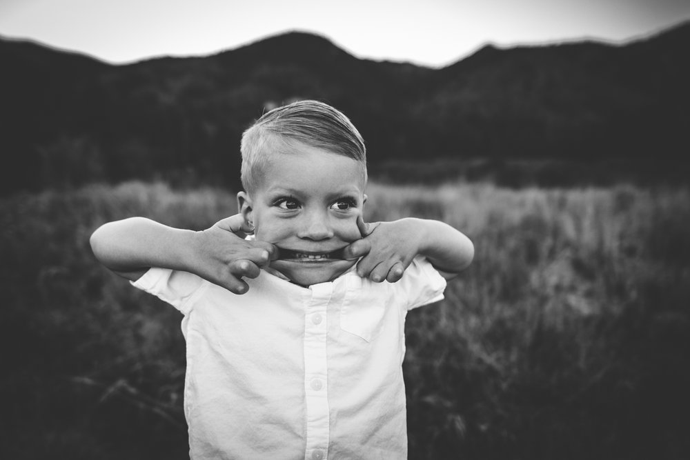 Little boy makes silly face during his family session in Colorado Springs.