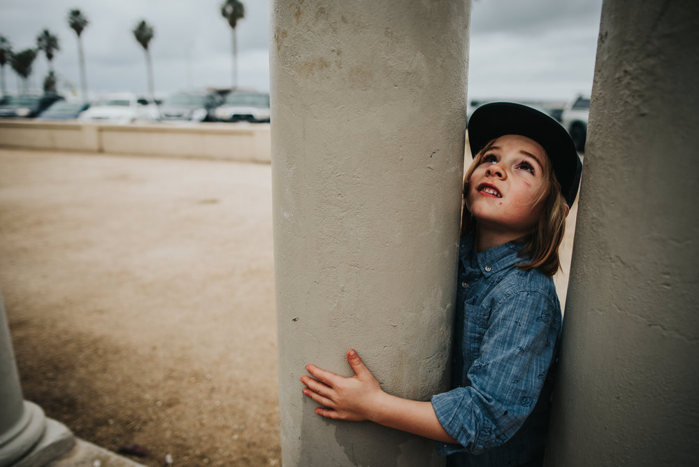 Little boy poses near Venice Beach in California.