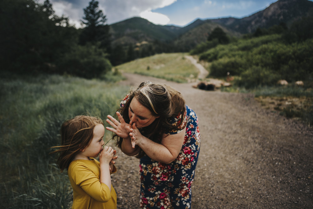 Mother and daughter share a sweet moment during their family session in the mountains outside of Colorado Springs.