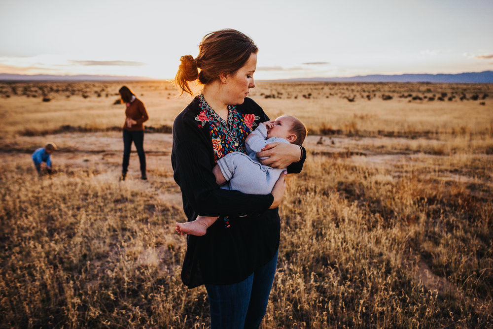 Mother of three boys enjoys spending the evening hours during sunset with her family on their cattle ranch in central Colorado with Wild Prairie Photography.