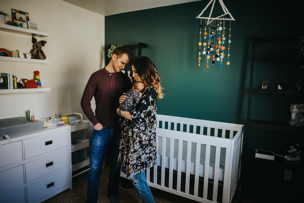 Mom and dad love on their newborn son in his nursery in Colorado Springs.