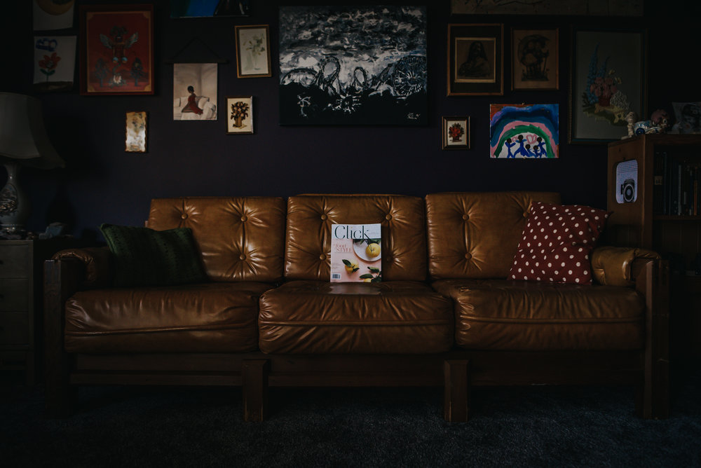 Colorado Photographer markets Click and Company Magazine in vintage living room.
