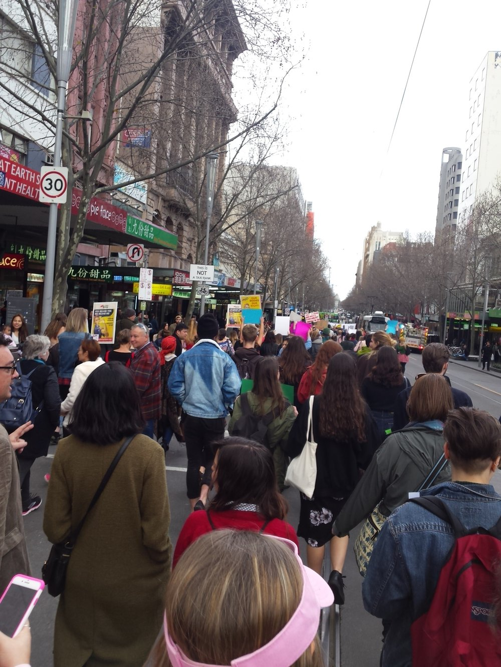 We march on down Swanston Street Melbourne as we chant