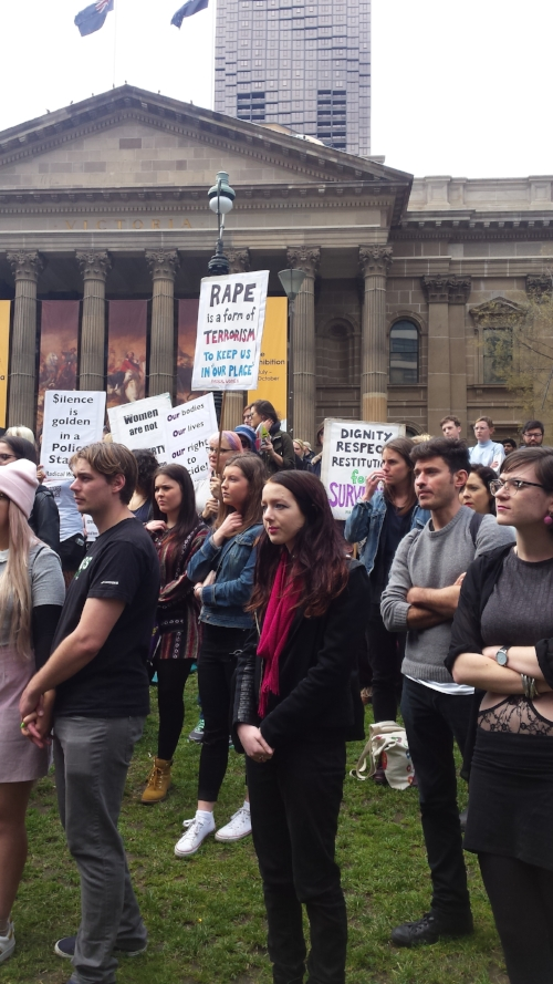 Men and women listening to the speeches outside the State Library
