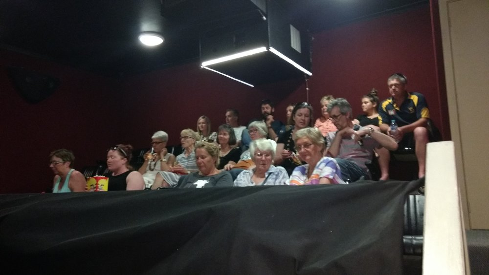 Audience in the mezzanine level watching the films