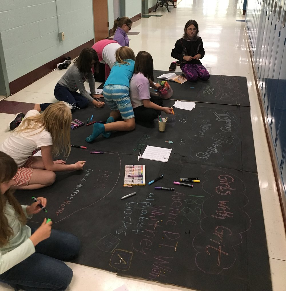 "Book club members create a giant ""graffiti wall"""