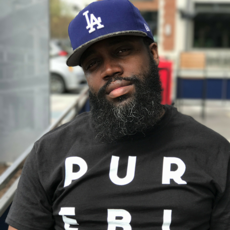"""Reggie Cunningham - Reggie is a D.C. area photographer and the creator of the """"Pure Black"""" lifestyle brand. A Ferguson protester from St. Louis, Reggie uses his brand to tell stories of the black experience while affirming the black consciousness.Instagram 