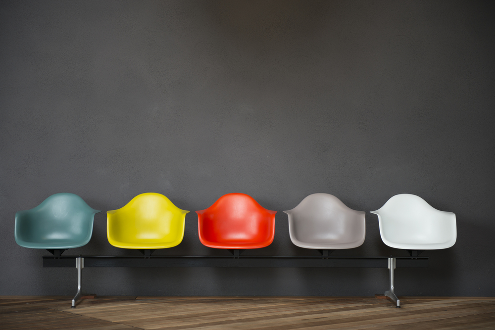 stock-photo-chairs-of-various-colors-arranged-in-the-classroom-136063367.jpg