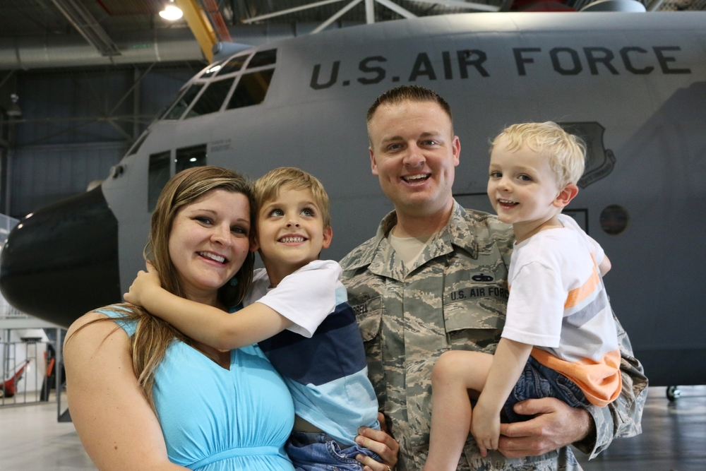 Tech. Sgt. Brad Harrell, his wife Amber, and their two sons, Luke and Jameson.