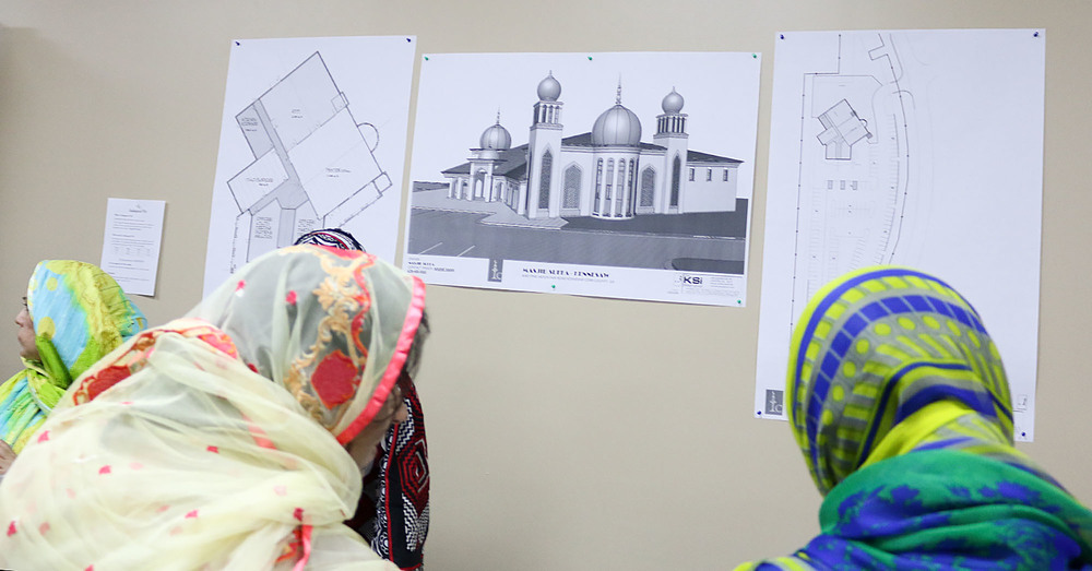 Plans for a new mosque are posted on the wall of the Masjid Suffah mosque in Kennesaw during Ramadan. The new mosque is planned to move in on Pine Mountain Road behind the Wallgreen's pharmacy.