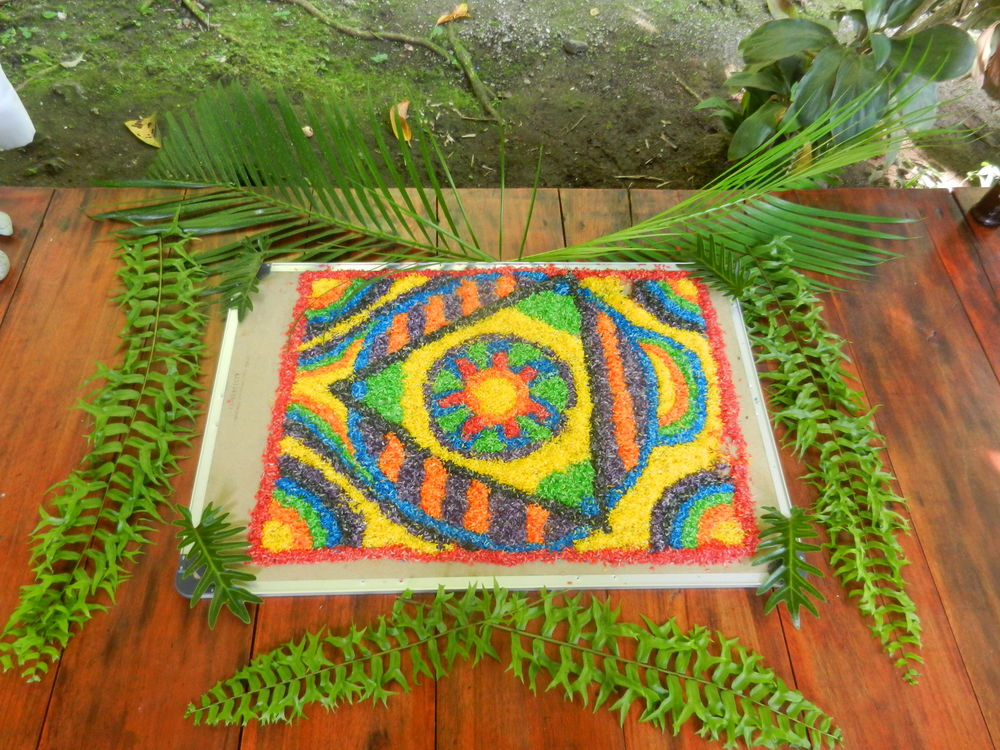 A Mandala created by the students with coloured grains of rice