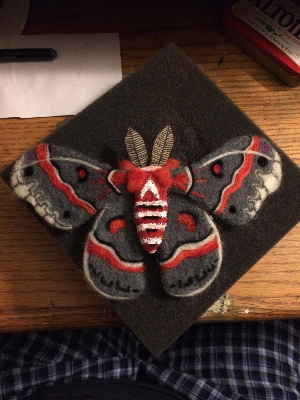 A cecropia moth made by wool needle felting.