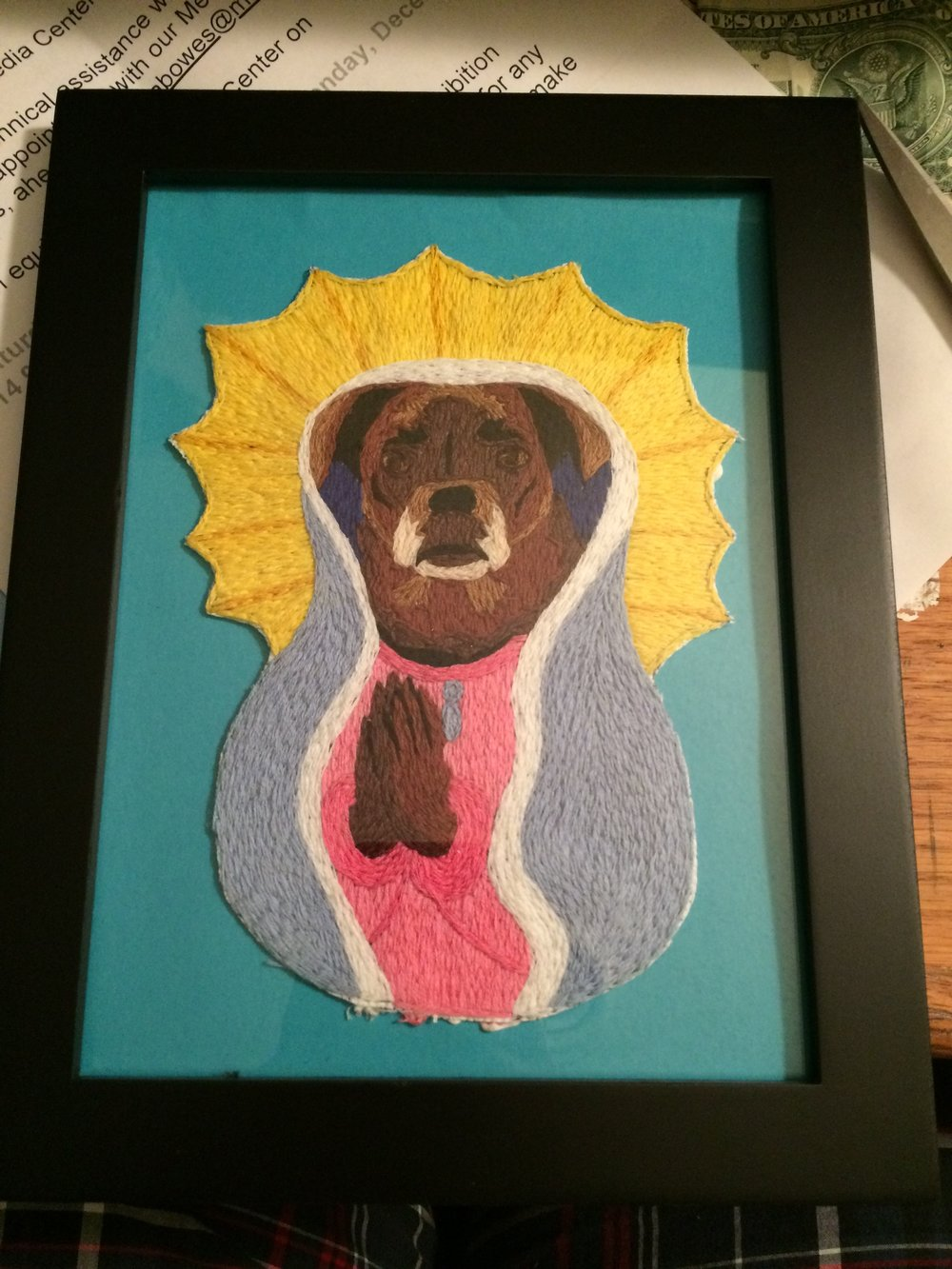 A commissioned portrait of someone's dog as Maria De Guadalupe.