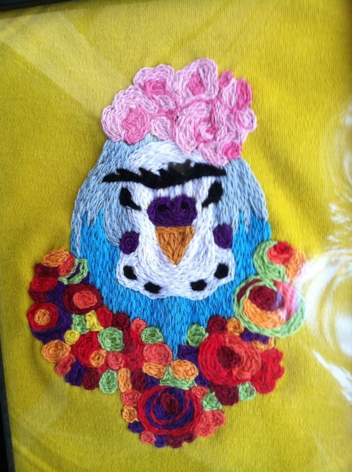 A commissioned portrait of a parakeet as Frida Kahlo.