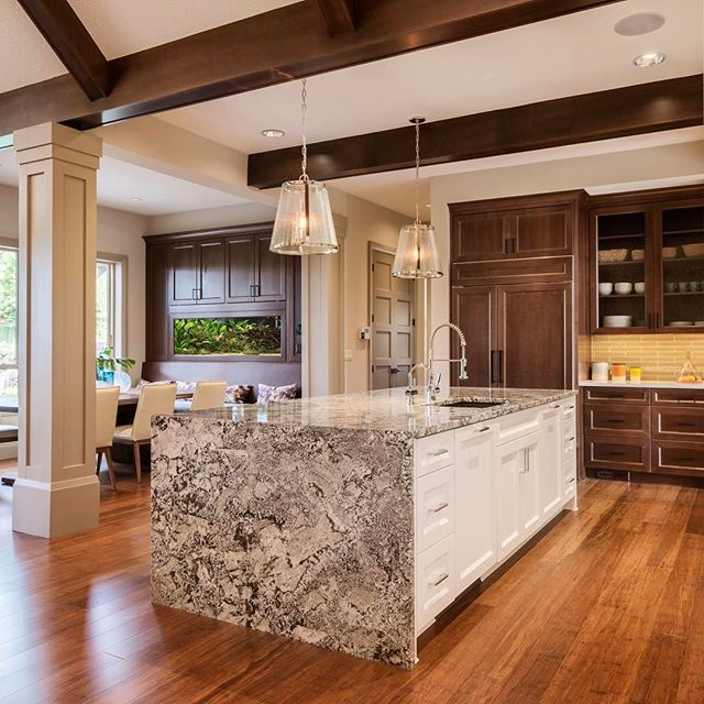 Namibian granite is a beautful blend of cool white and grey tones with warm gold and cream tones. It nicely ties in the white and chocolate cabinetry and trim. Really pleased how this island brightened up the kitchen.  #interiordesign #interiors #interior #interiorstyling #instadesign #mystyle #kitchendesign #classic #luxury #timeless #portland #instaportland #cabinet #pendant #interiordecor #accessories #kitchen