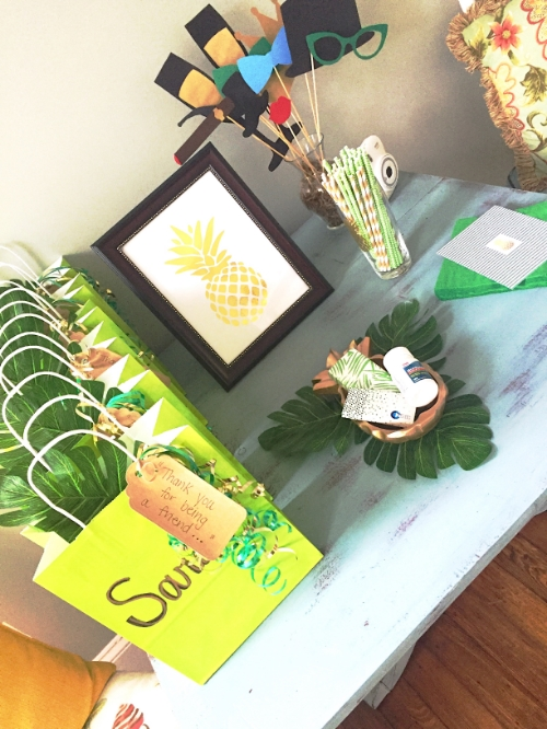 A hospitality table for my friends complete with photo booth props I made.