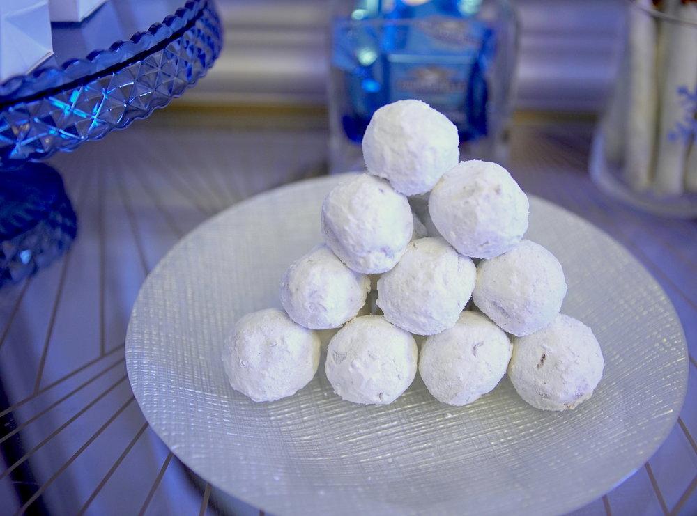 """Snowballs"" (powdered sugar donut holes)"