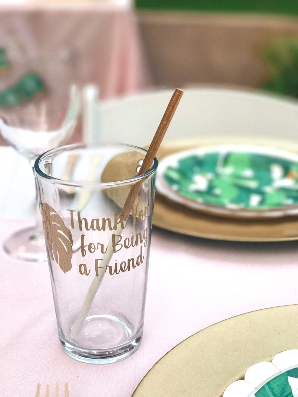 I designed this print, used my Cricut to cut it out of vinyl, and applied it to dollar store drinking glasses. These doubled as favors for my guests.
