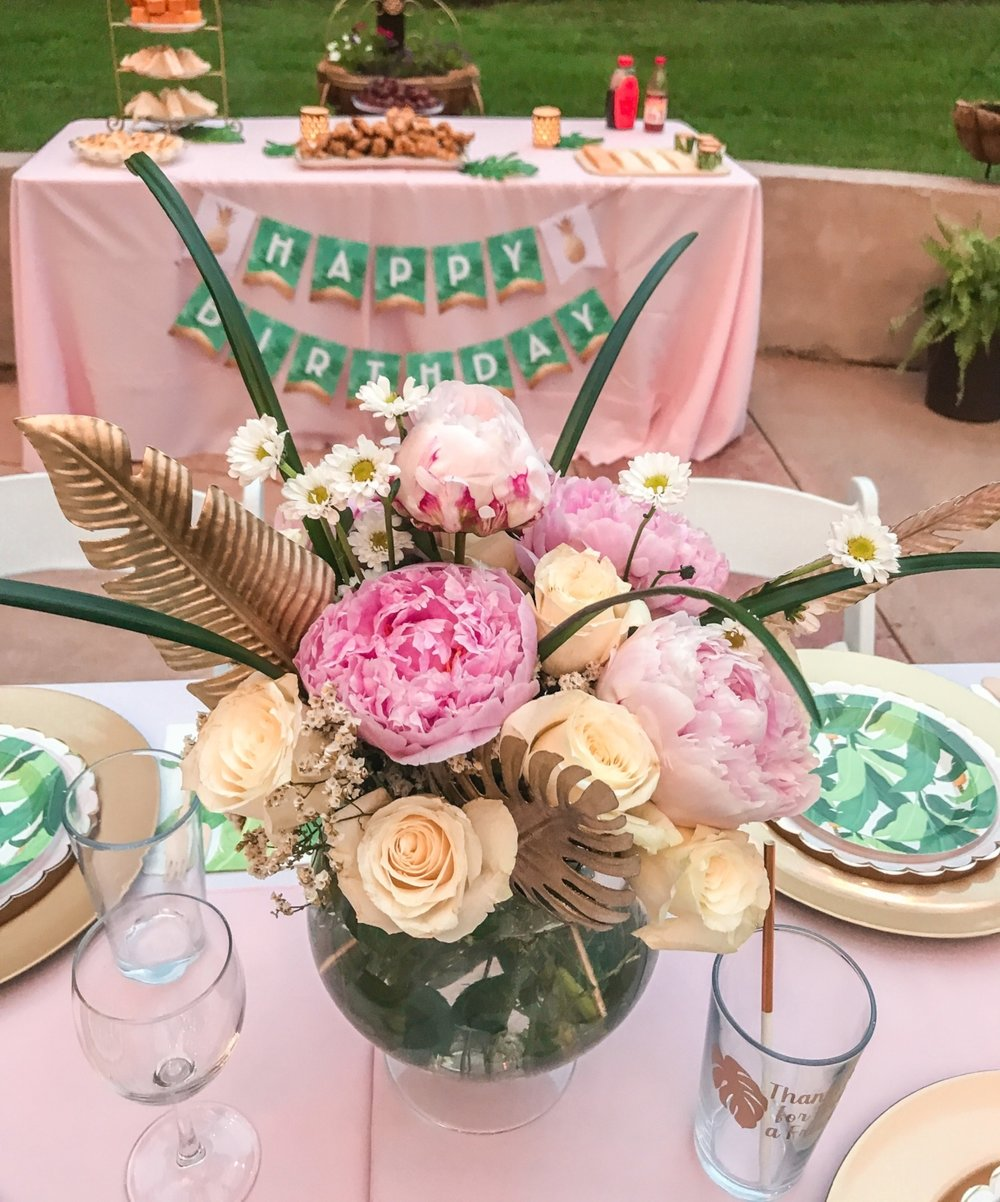 Can we talk about these AMAZING floral picks from Jo-Ann's?!? As soon as I saw them I knew they'd go in an arrangement for the centerpiece. I used white roses and pink peonies with some baby's breath and daisies as a simple yet beautiful arrangement. The picks really brought out the gold accents on the table!