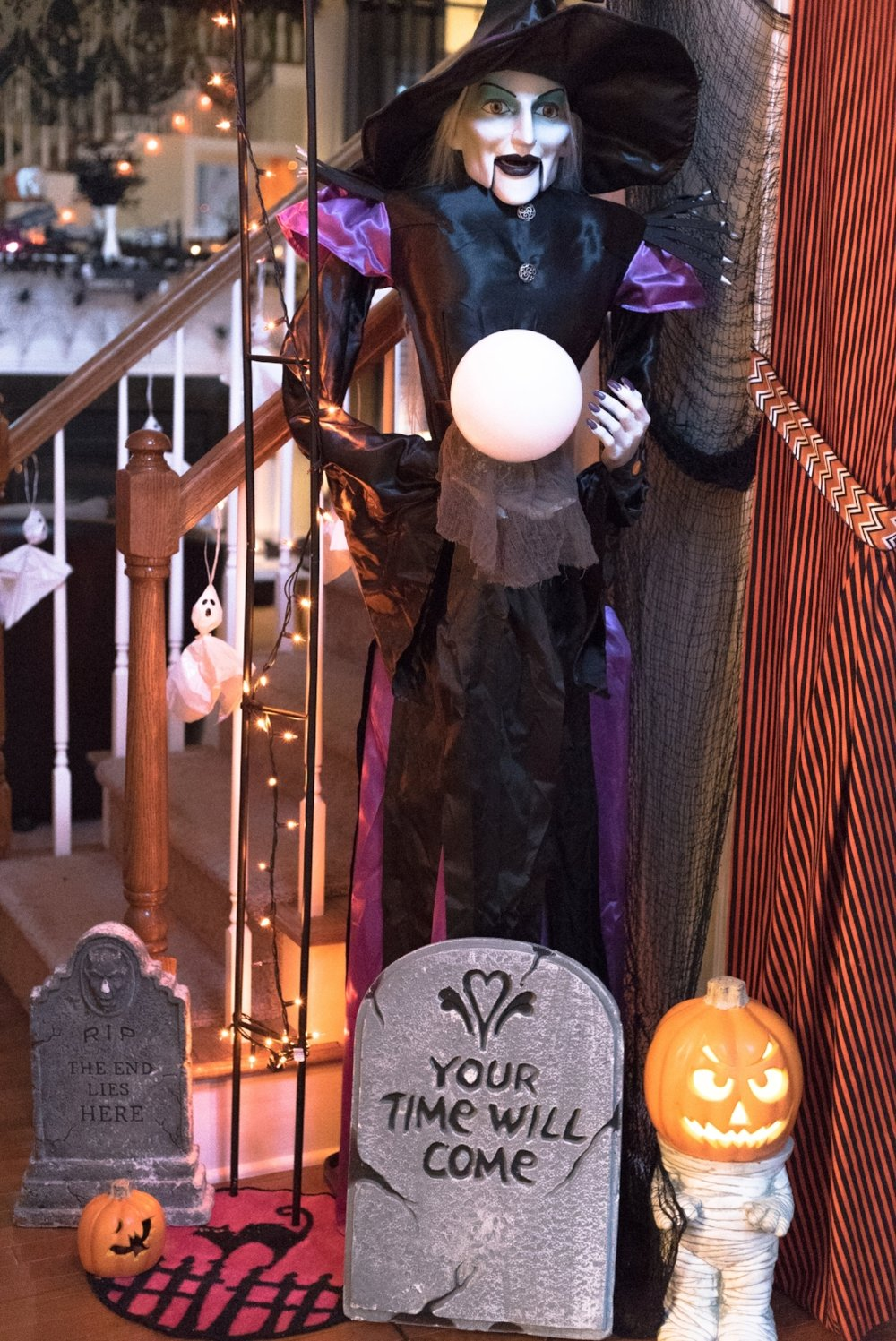 I use foam tombstones, Target Dollar Spot rugs,and spooky cloth to help hide cables.