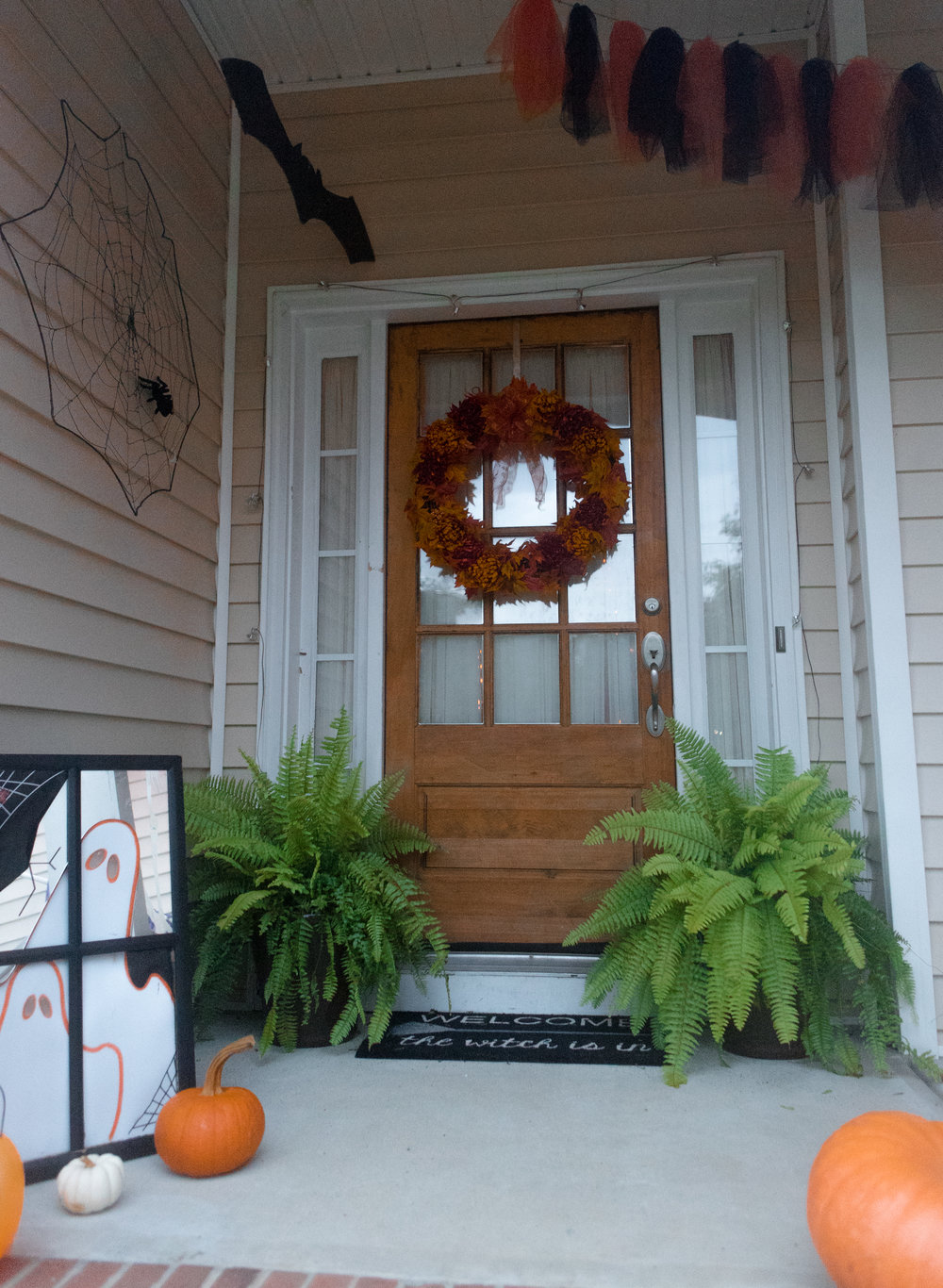 I put this fun mirror on the porch to go with the orange, black, and white theme this year! I made the bat by cutting it out of plywood and painting it black. I got the tulle idea from Pinterest as I was looking for something different to fill some ceiling space on the porch!