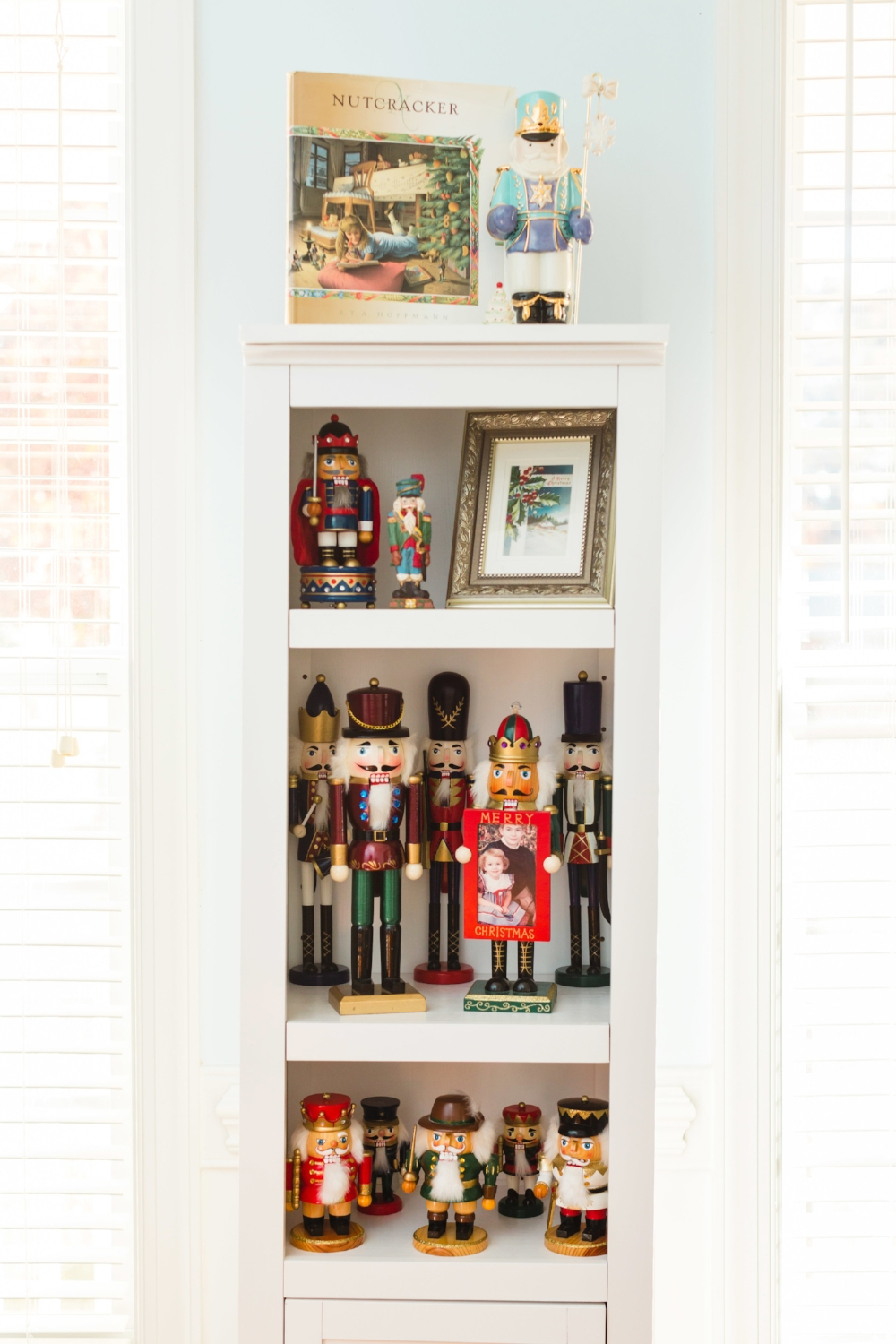 My nutcracker collection displayed in the dining room. I love the one with a throwback pic of my brother and I!
