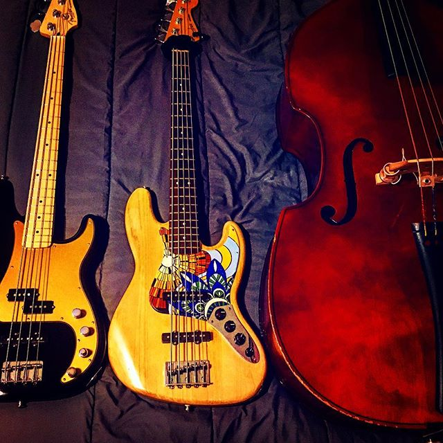 |Tres Amiga|  Carlita (Nueva), Natasha y Isabella  Just got my new (to me) @fender Deluxe P/Jazz Bass(mexi). Recently brought Carlita(left) &Natasha (middle) to @strangeguitarworks in New Orleans.  Benjamin and Aaron are true craftsman with amazing customer service and honesty.  I'll be damned if I take my ladies anywhere else while I'm down here. (Videos soon👍) • • • • • • #allthefilters #tresamigas #bassplayer  #alldayeveryday #exceptwhenisleep #but  #idream #of #basslines #still #fenderbass  #uprightbass #precisionbass #jazzbass  #plybass #bed #downsouth