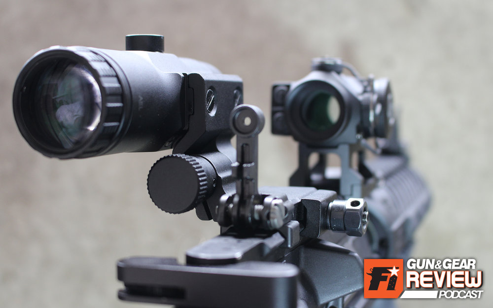 The magnifier should hover above most flip up iron sights available for the AR-15. This Griffin Armament M2 sight is the same height when collapsed as the Magpul BUIS rear sight, so both work in combination with the VMX-3T and whatever red dot you prefer.