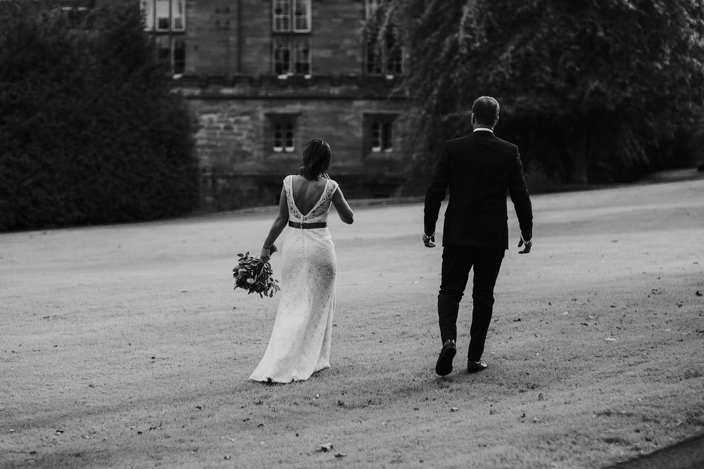 Bride and groom are walking on the ground castle.