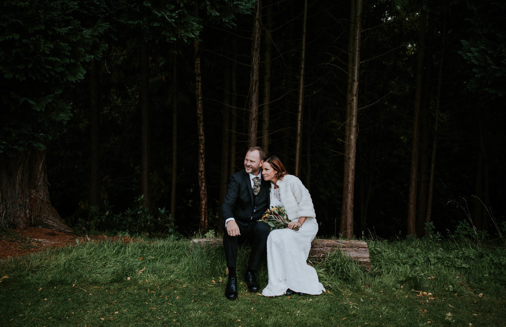 Bride and groom at the forest.