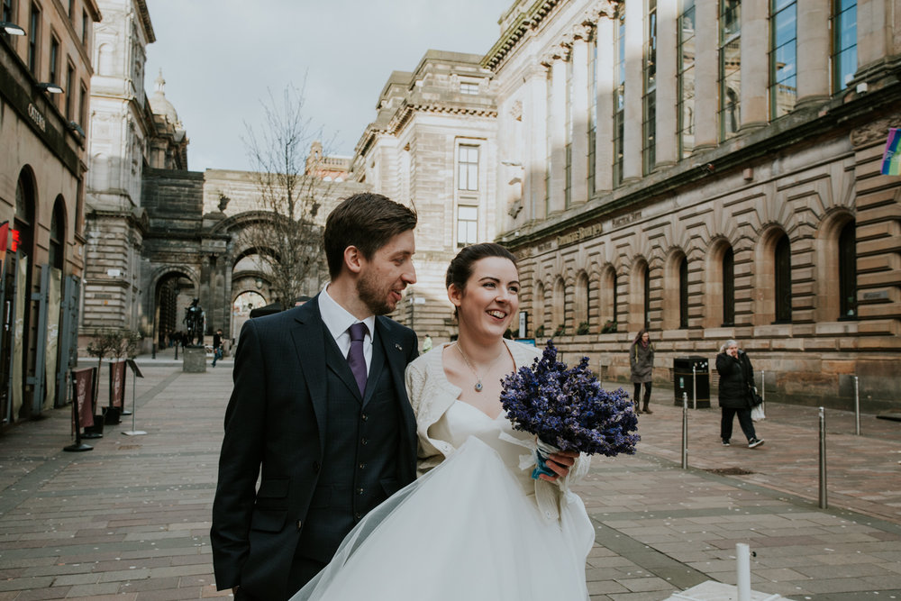 Bride and groom are walking in the Merchant city, Glasgow