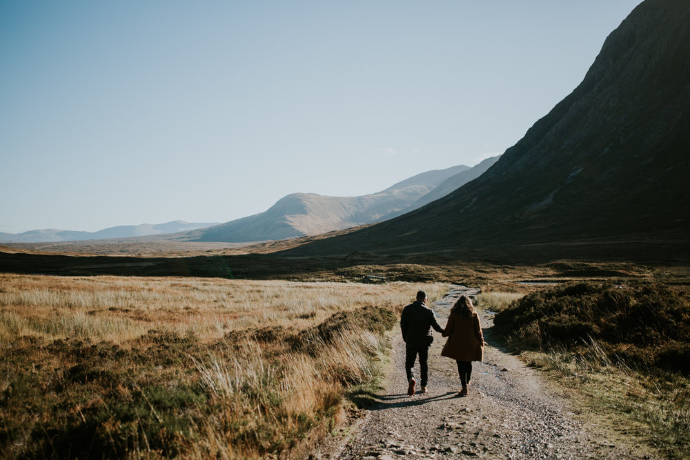 Couple are walking in Glencoe, Scotland