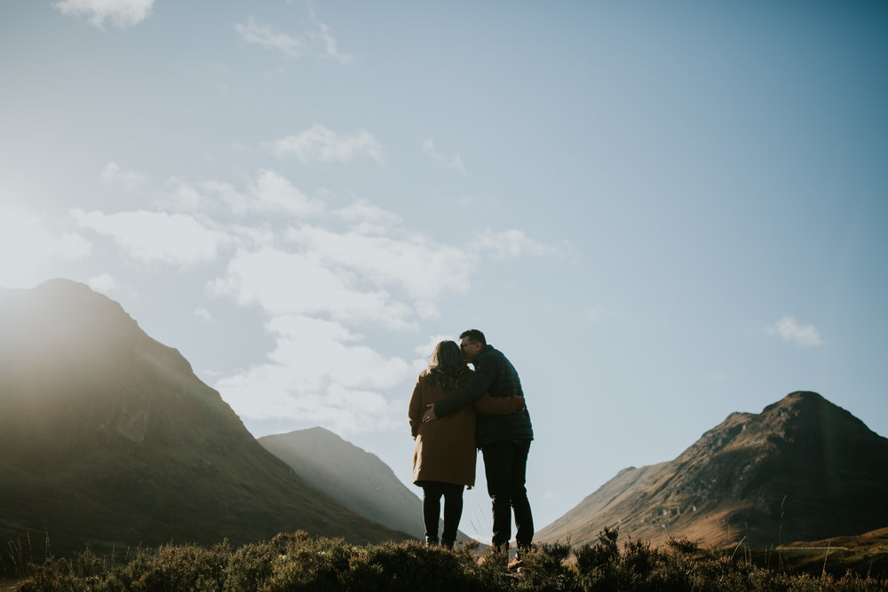 Couple's kiss in a sunny Glencoe, Scotland