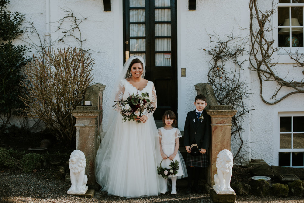 Bride with flower girl and page boy