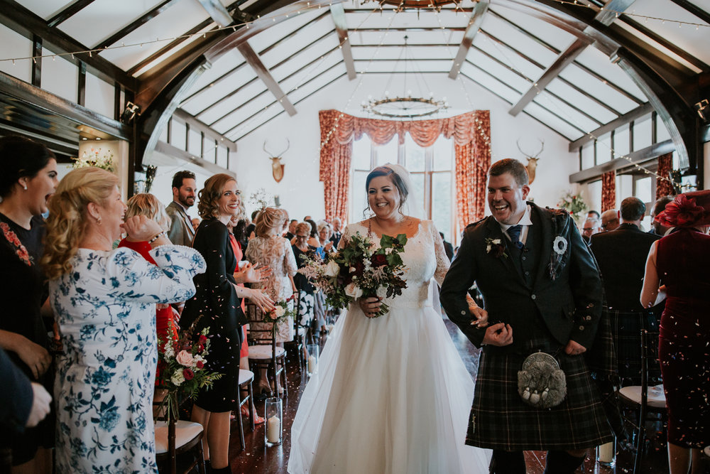 Confetti exit as a husband and wife. Brig o' Doon Ayrshire Wedding Photographer