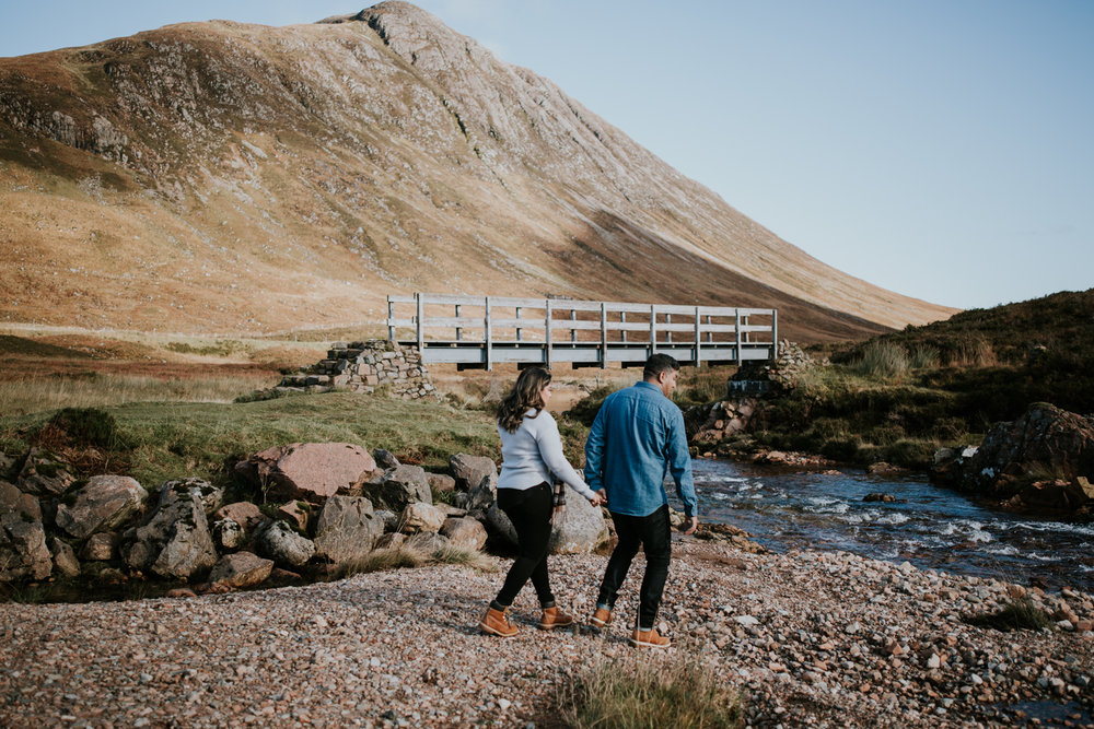 Couple is walking in Glencoe, Scotland