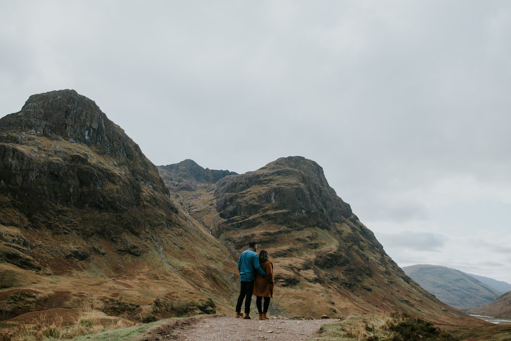 Couple is together in Glencoe, Scotland