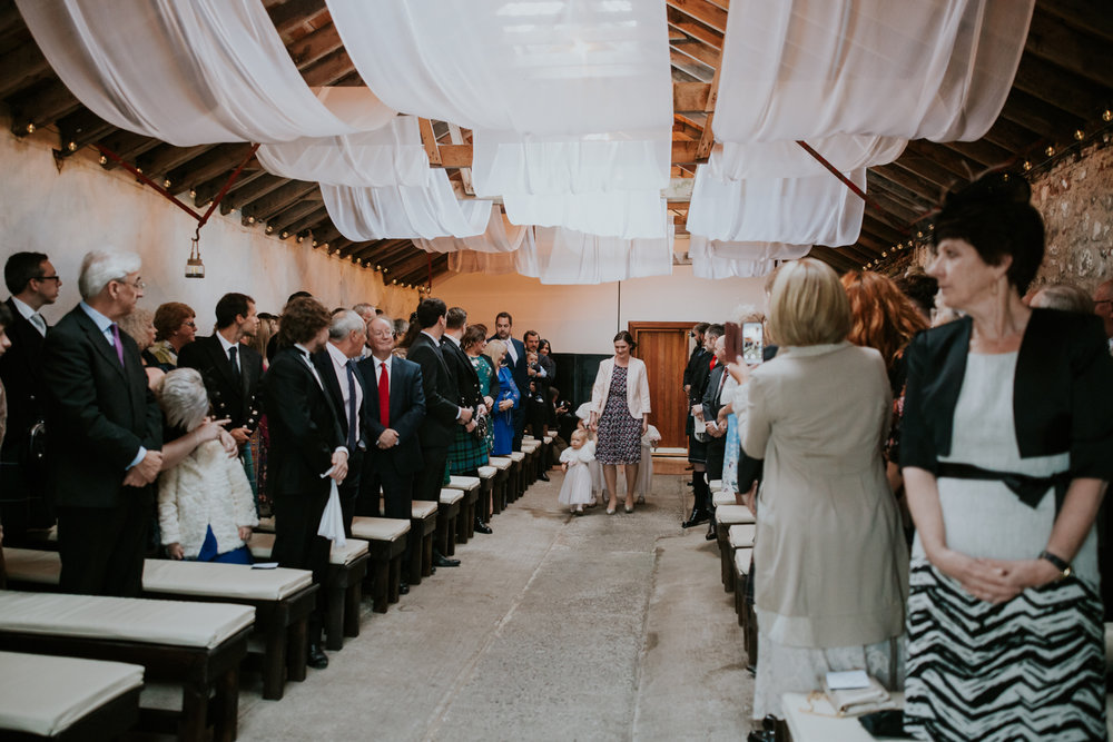 Flower girls walks at the aisle of Harelaw farm