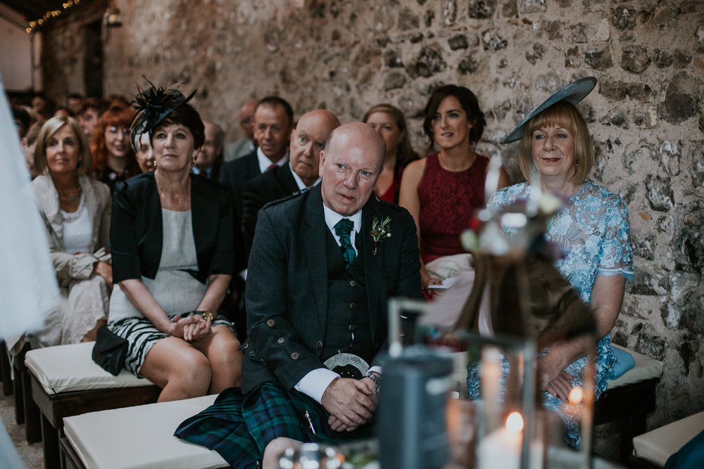 Bride of the father is looking at his daughter during the ceremony at Harelaw farm, Ayrshire