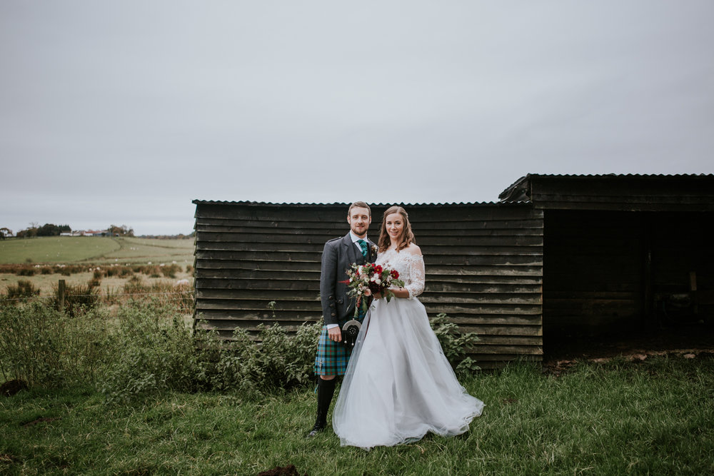 Newlywed boho couple's portrait in the field of Harelaw farm. Ayrshire wedding photographer.