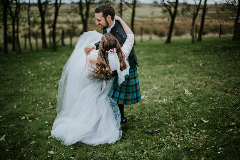 Bride is having fun in Flossy and Dossy wedding dress. Harelaw farm, Ayrshire.