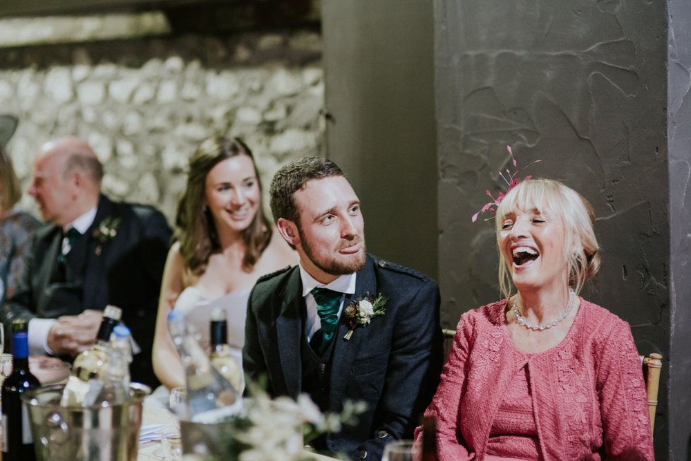 Groom and his mum are laughing at the wedding reception at Harelaw farm DIY wedding.