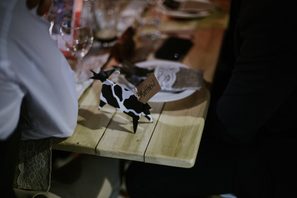 Origami cow on the table at the wedding reception at Harelaw farm DIY wedding in Scotland.