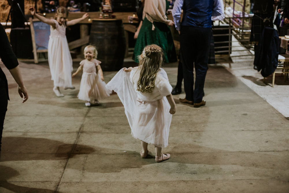 Children on weddings. Flowers girls are dancing at Harelaw farm.
