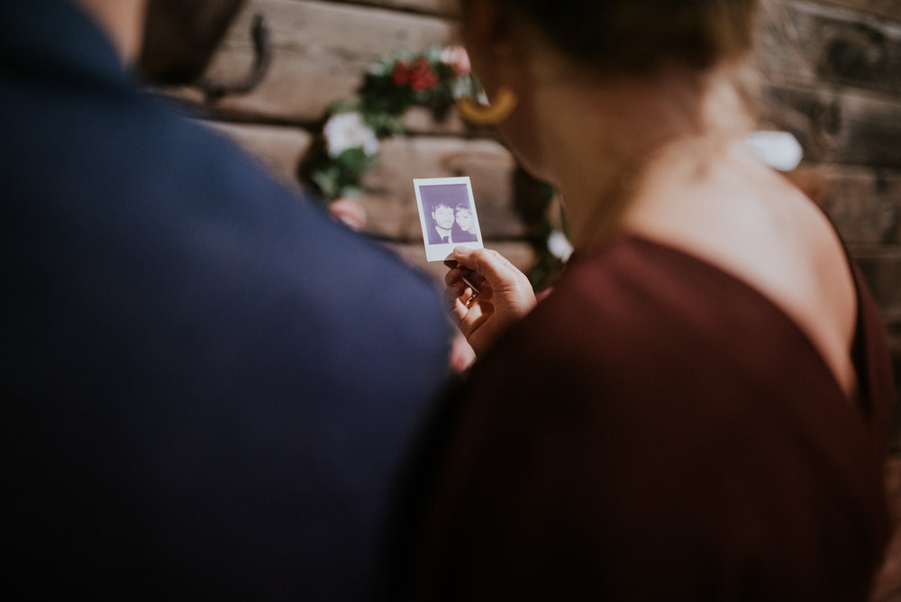Guests looks at the polaroid photo.