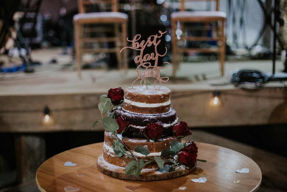 Naked wedding cake with the red roses at Harelaw farm DIY wedding in Ayrshire.