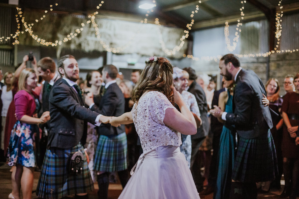 Newlyweds couple is on the dance floor at Harelaw farm DIY wedding.