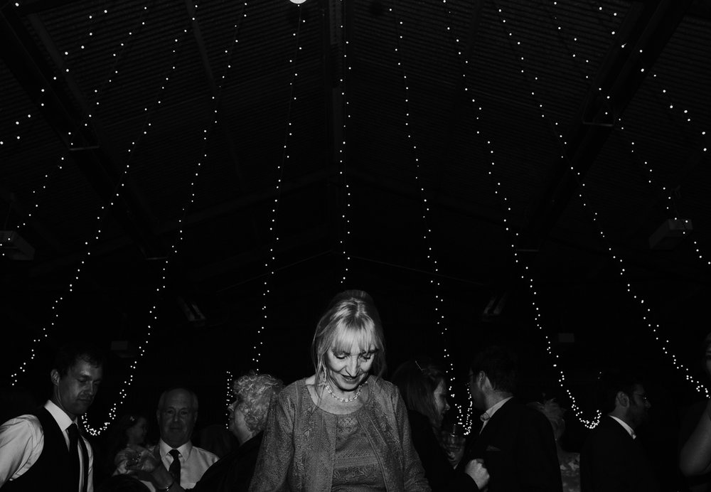 The groom's mum on a dance floor at Harelaw farm DIY wedding in Ayrshire.